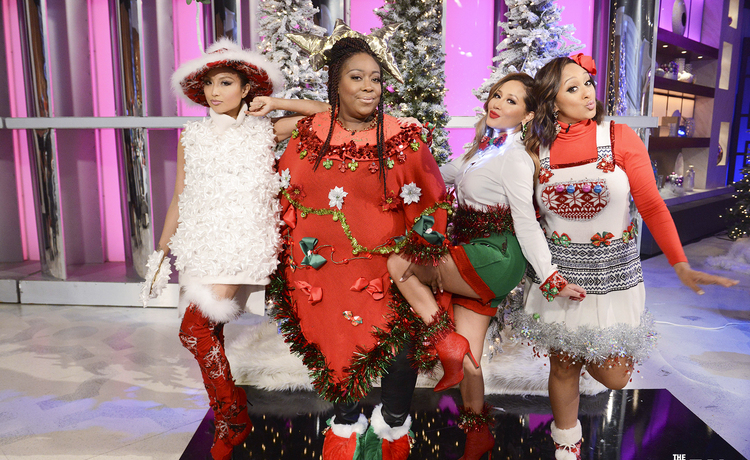 VOTE for the Ugly Sweater Champion!