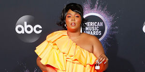 Lizzo Makes Big Statement with TINY Purse!