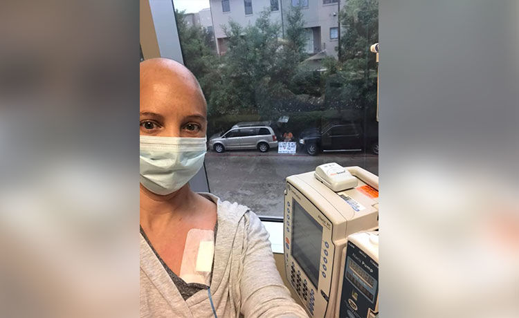 Husband Supports Cancer-Stricken Wife with Heartfelt Sign at Chemo
