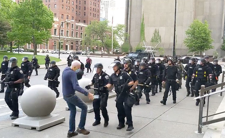 2 Buffalo Police Officers Suspended After Pushing 75-Year-Old Man to Ground During Protest